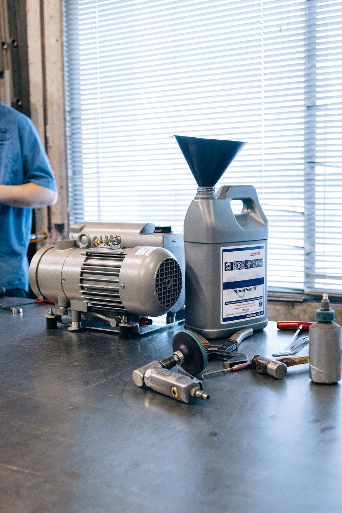 A Becker vacuum pump being serviced by a REM Equipment technician.