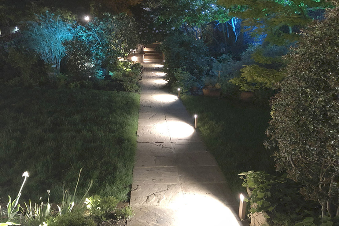 Garden path lit with focussed bollards