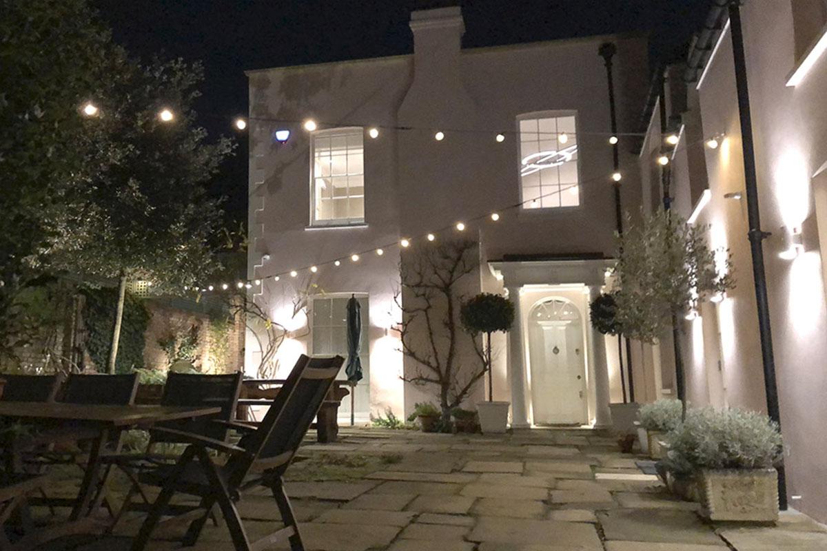 Festoon lights in courtyard, London