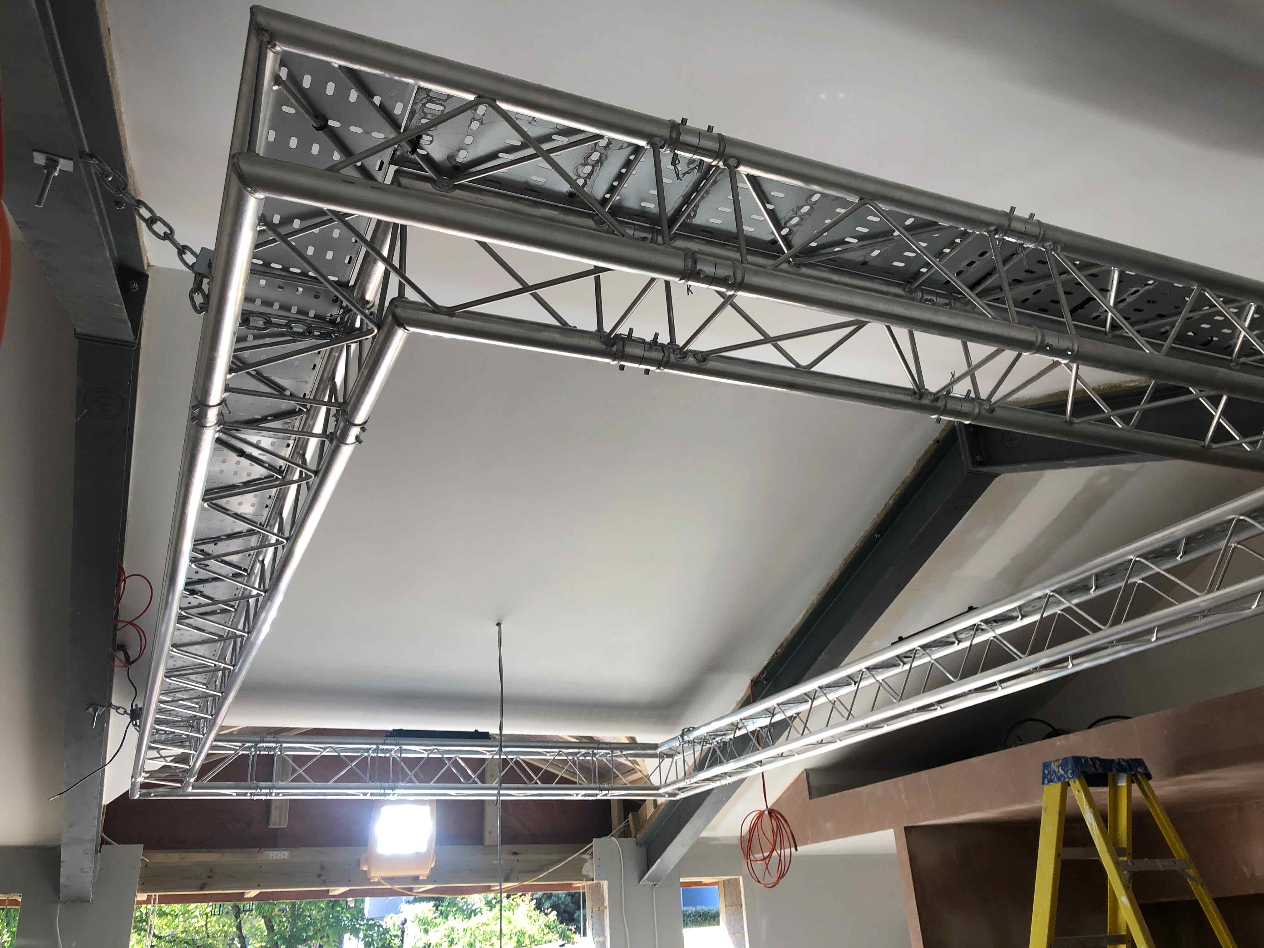 Theatrical lighting truss in party room