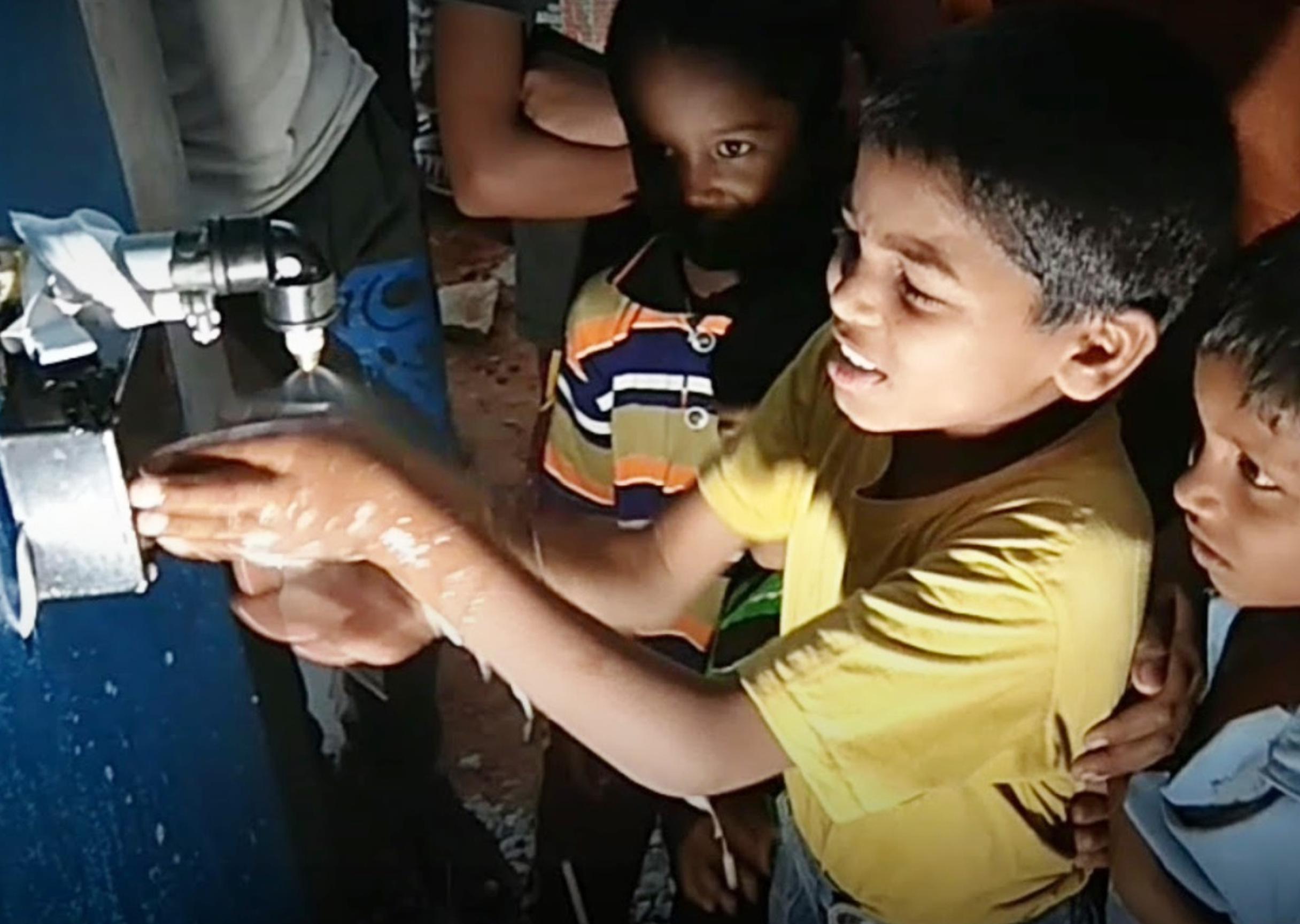 Indian children using 8200 IMPACT Alumnus Soapy machine
