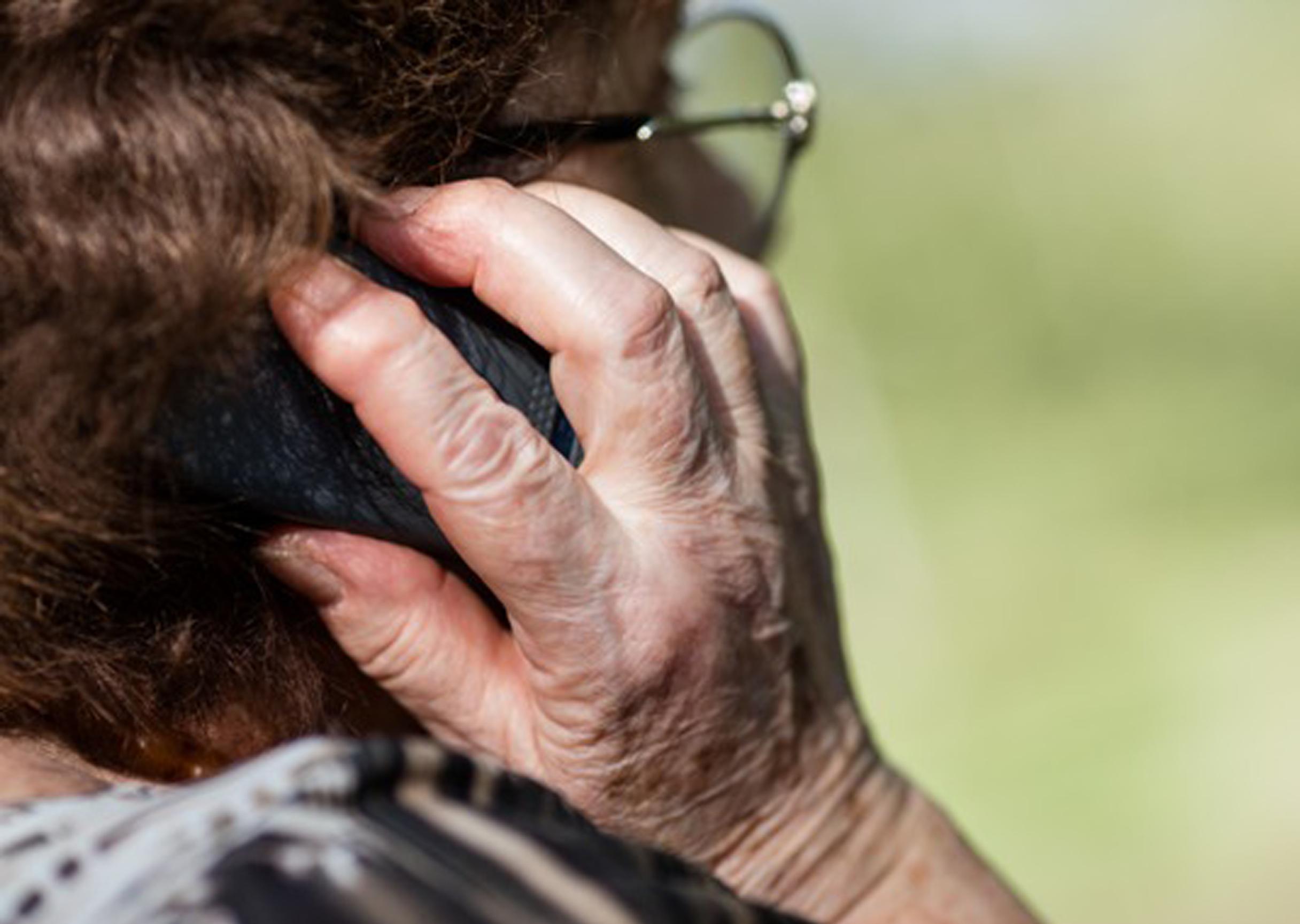 Elderly woman checks hearing with Tunefork