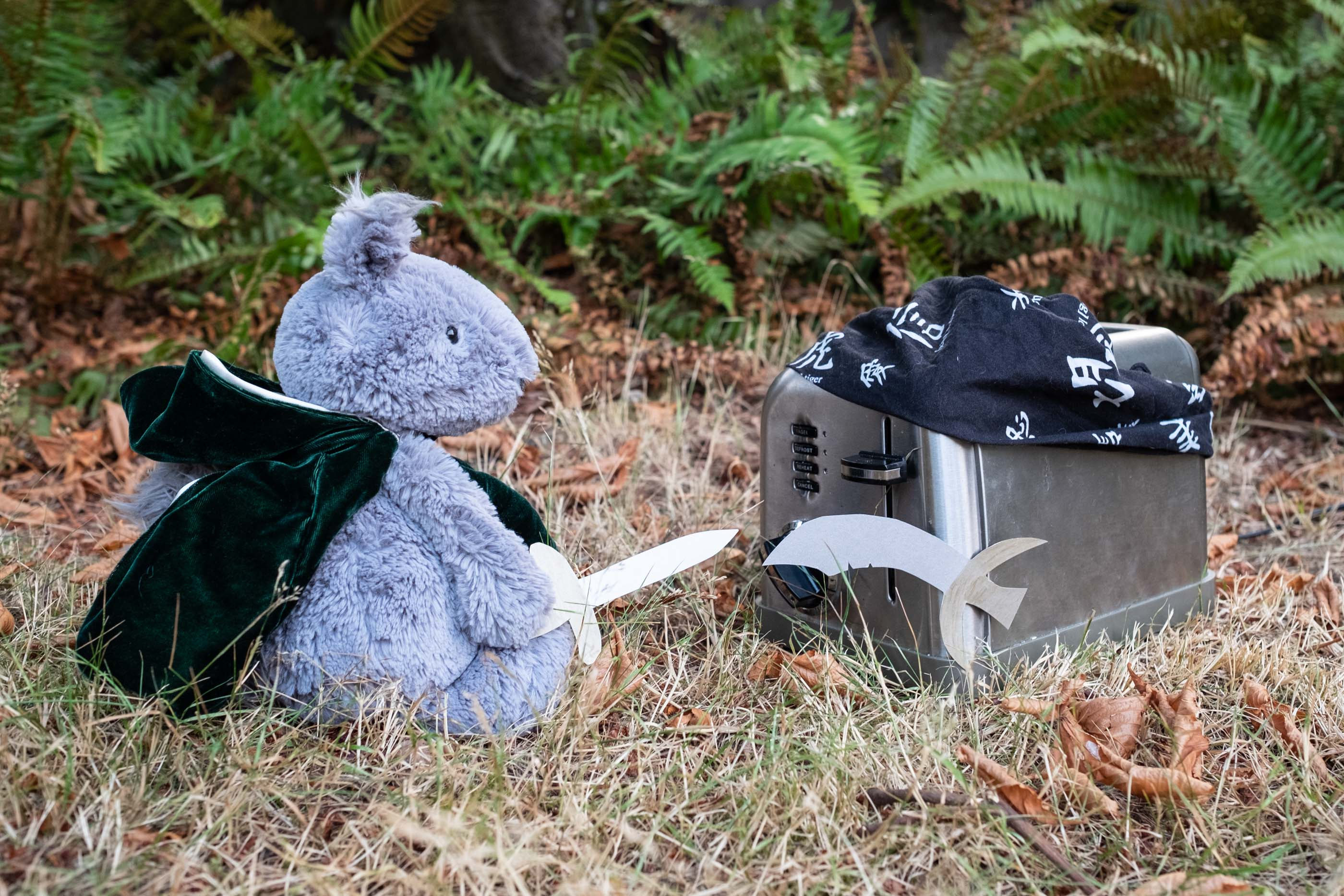 Stuffed animal squirrel fighting a toaster