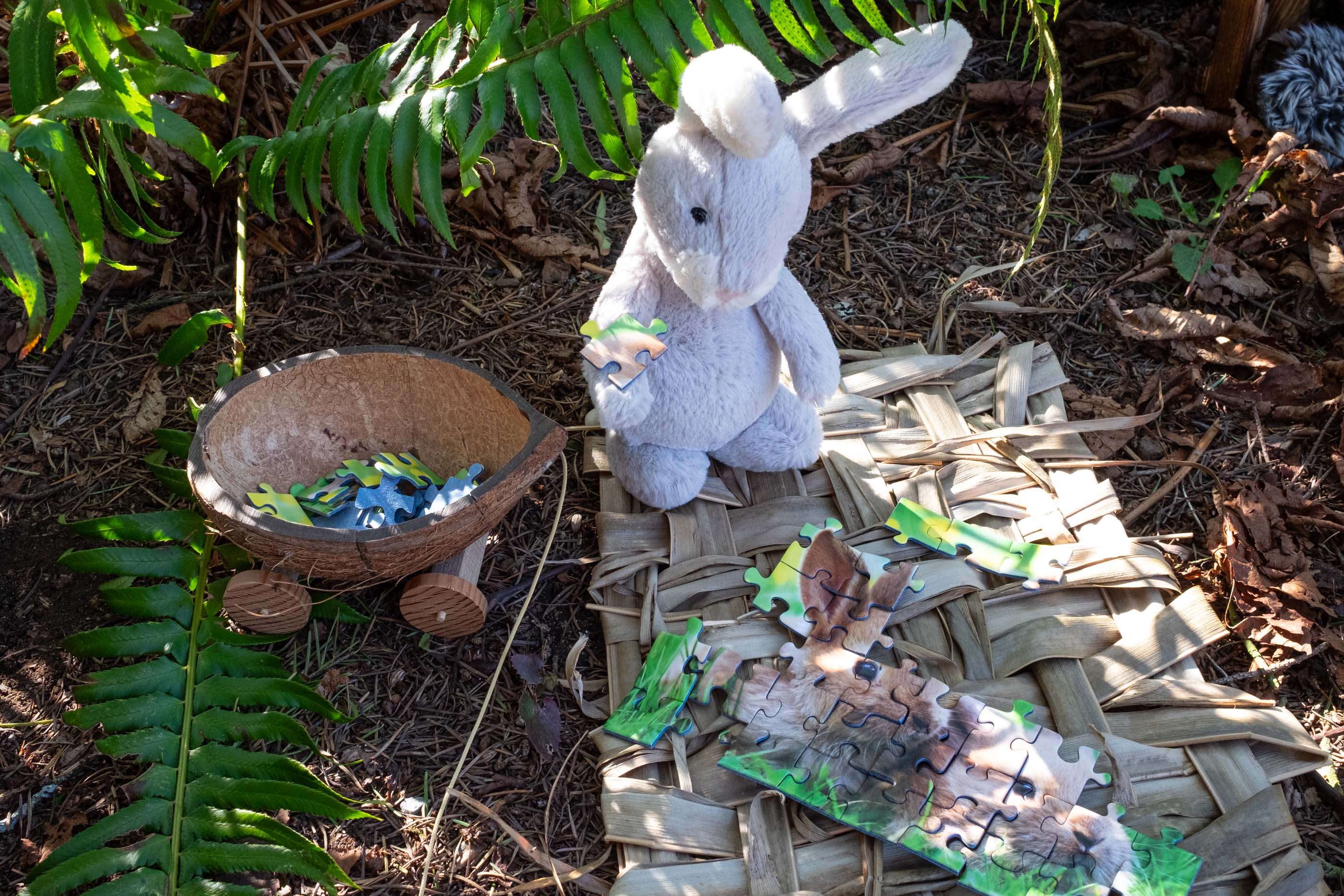 stuffed bunny doing a jigsaw puzzle