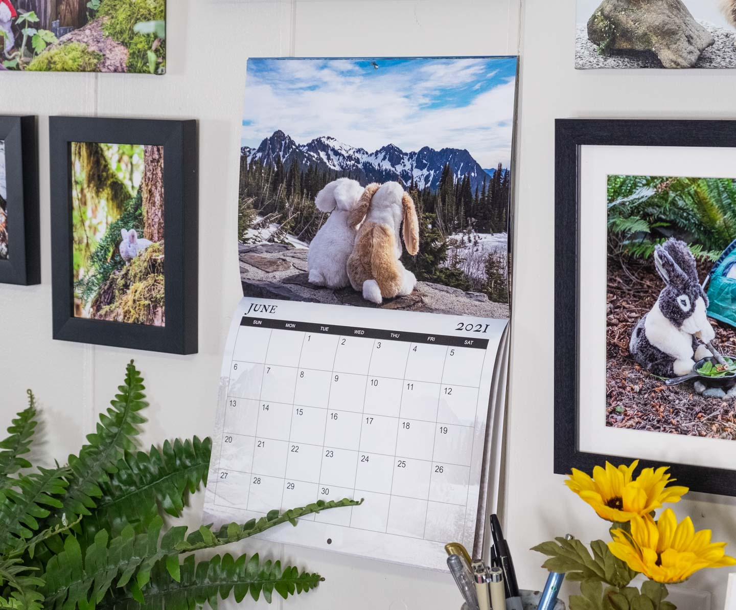 Wall calendar with a picture of two stuffed animal bunnies