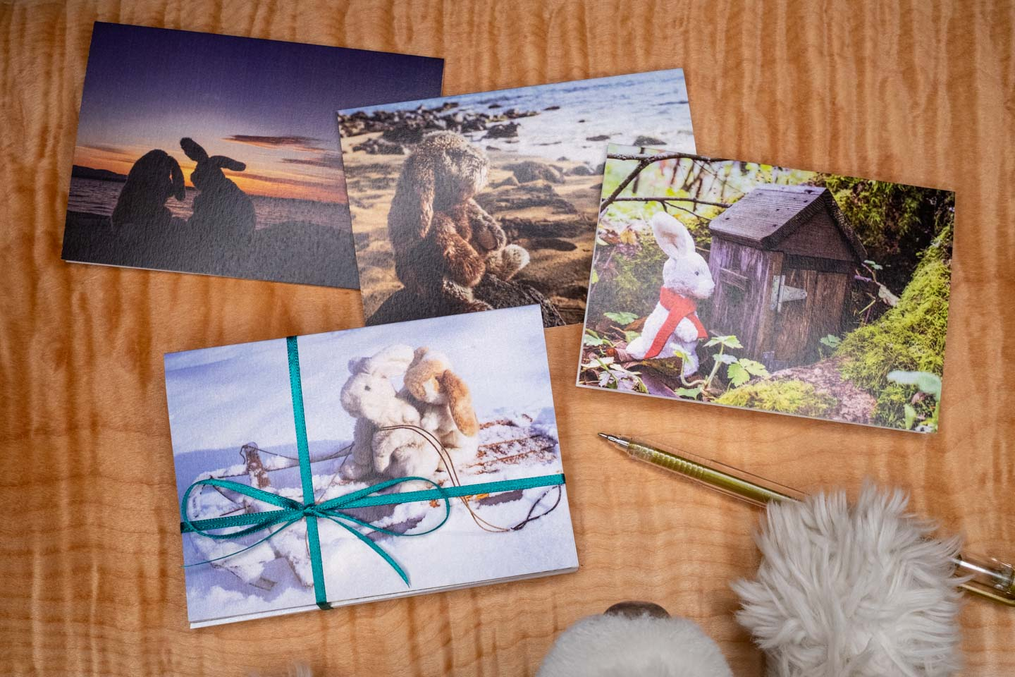 Teddy bear writing on notecards with stuffed animal images on them