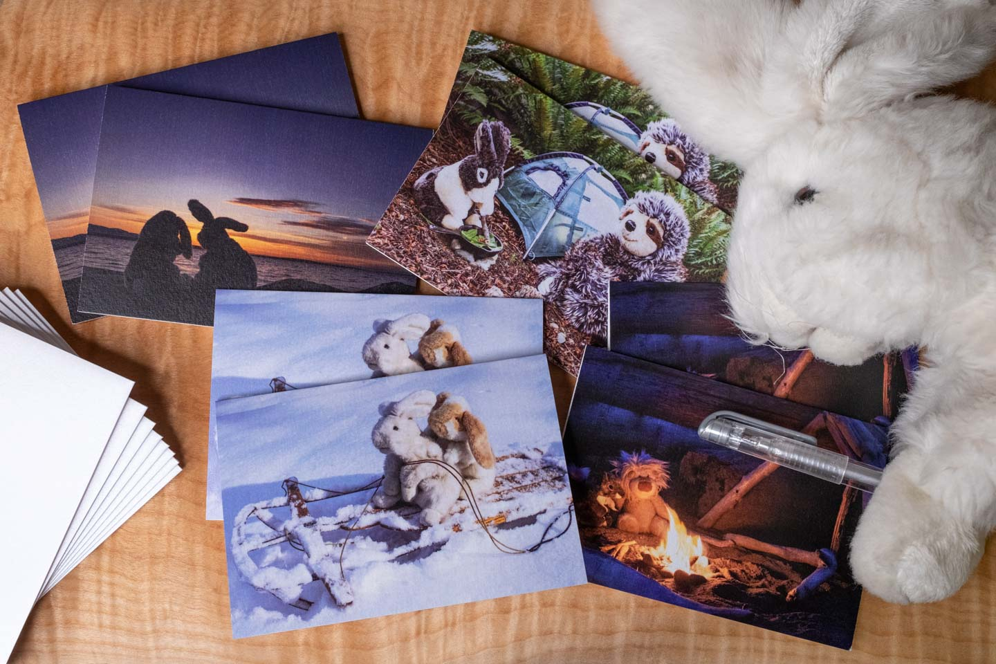 Set of notecards with four different images of stuffed animals hanging out in pairs