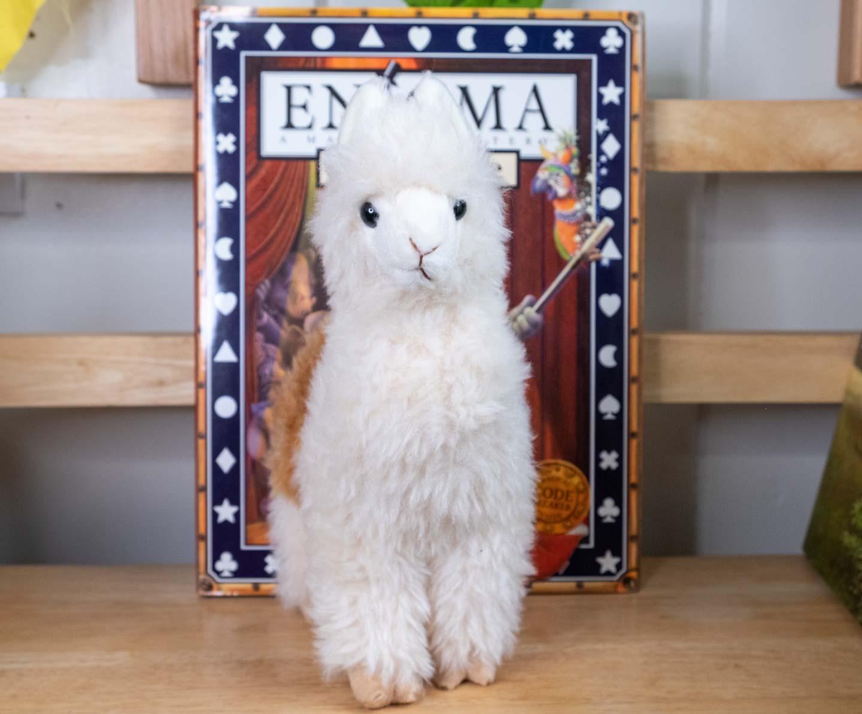 Brown and white plush standing alpaca
