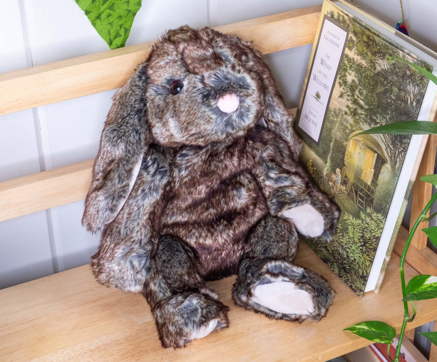 Brown plush lop bunny in a seated posture