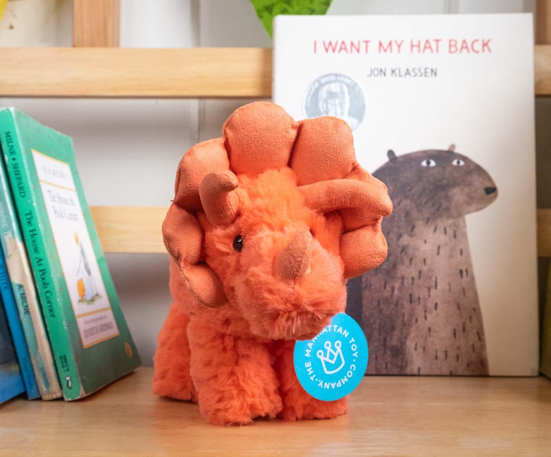 orangey-pink plush triceratops