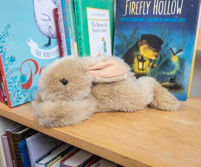 Lying-down tan plush bunny
