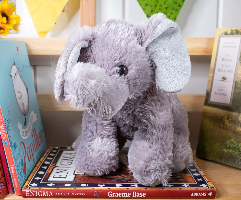 Gray sitting plush elephant with floppy ears