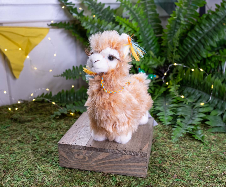 Plush llama with very short legs