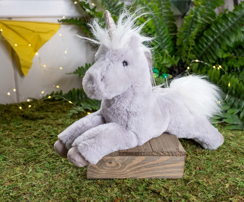 Gray plush unicorn lying down