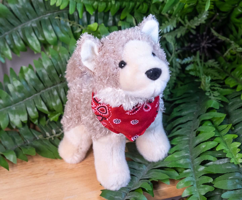 Sitting plush coyote with red bandana