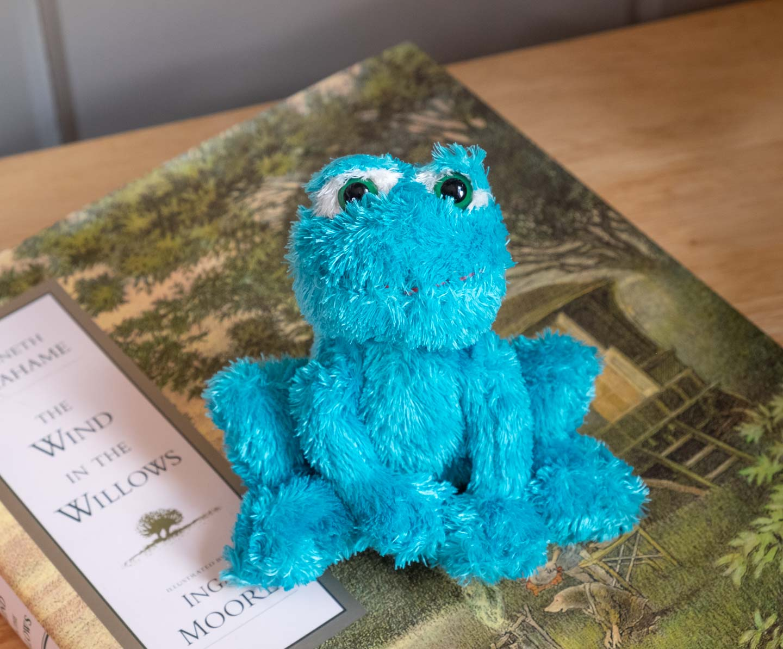 Small blue squatting plush frog