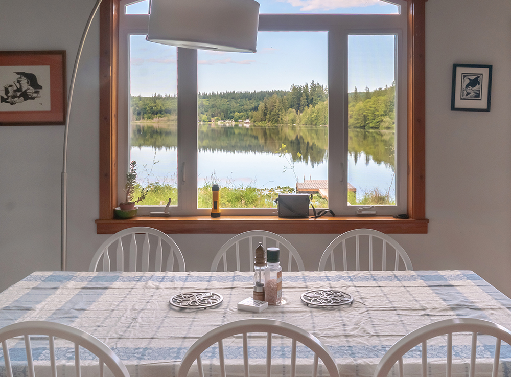 dining table photograph of leland lake house with lake visible through window