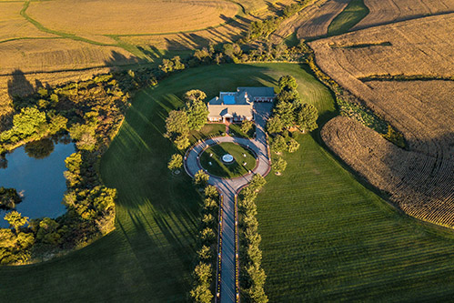 aerial shot of mansion on larger property
