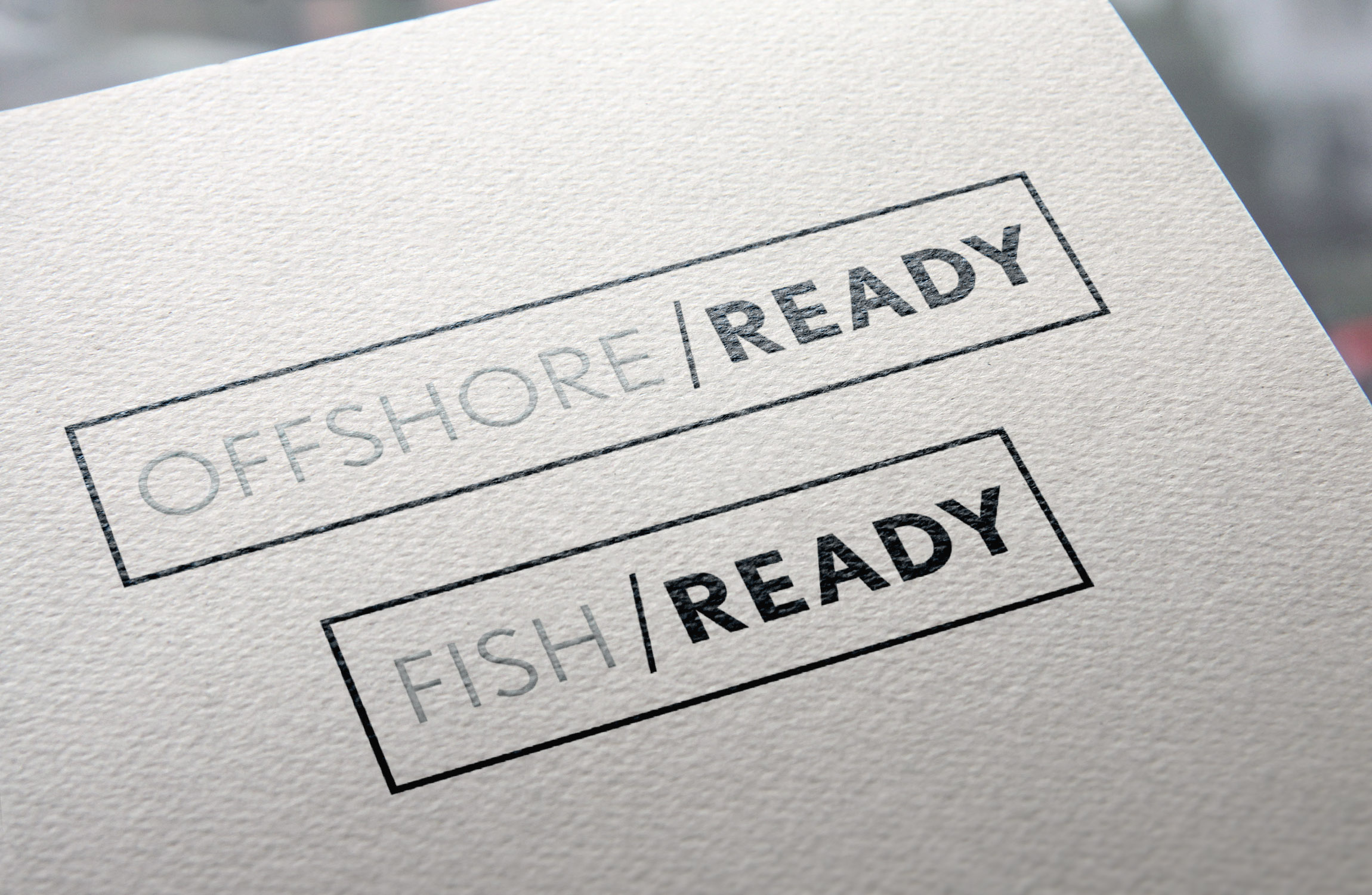 ocean ready logo mocked up on cardstock paper the words ocean and ready are in a rectangular box separated by a back slash