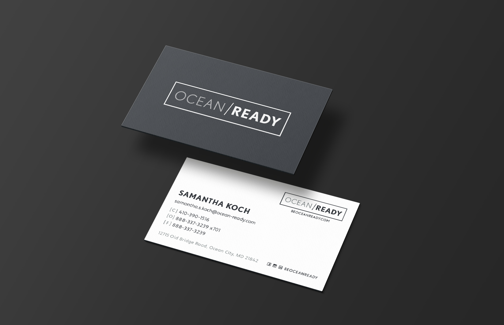 mockup of front and back design of ocean ready business card with solid grey background