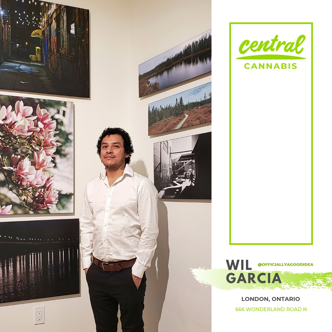 Wil Garcia, local London, Ontario photographer poses with his exhibition at Central Cannabis.