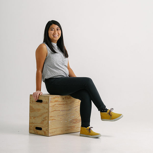 Photo of Janey Jones sitting on a wooden box.