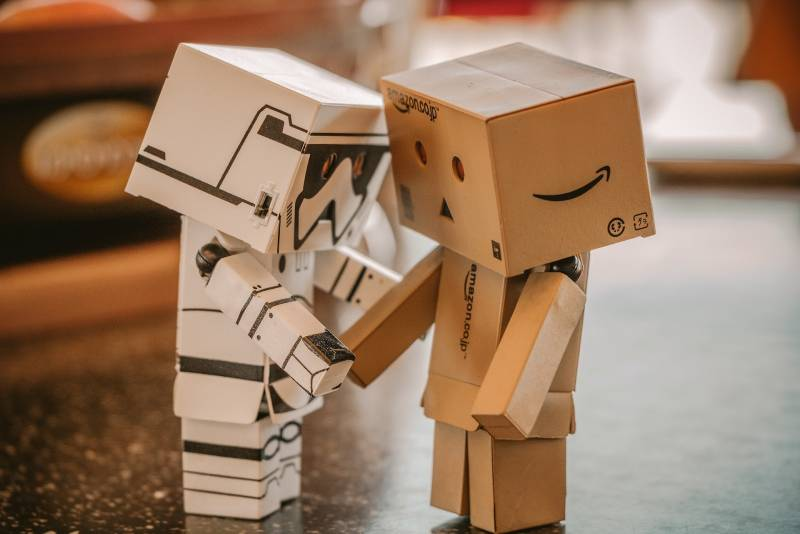 How much does a financial advisor cost? Two cardboard robots
