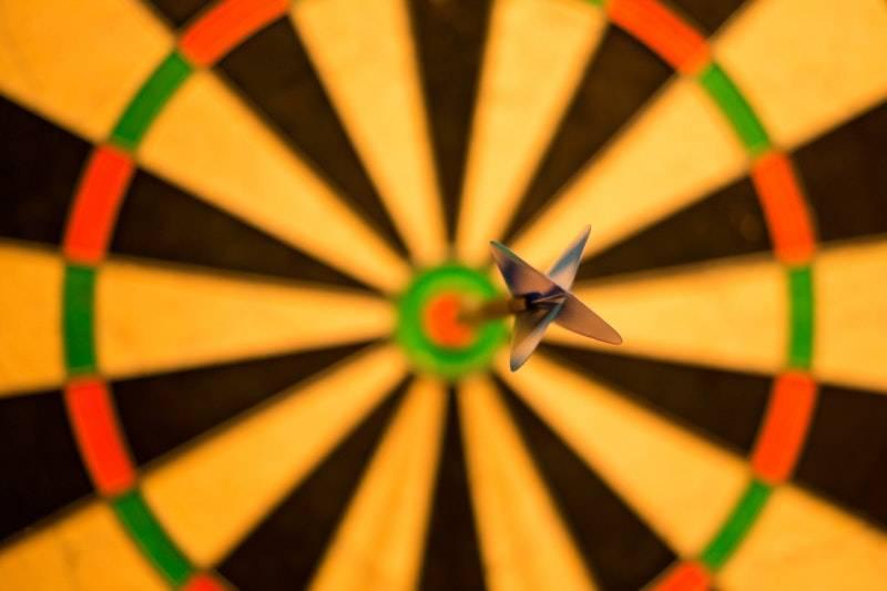 How Much Money Should I Have Saved by 30? Closeup of bullseye dart
