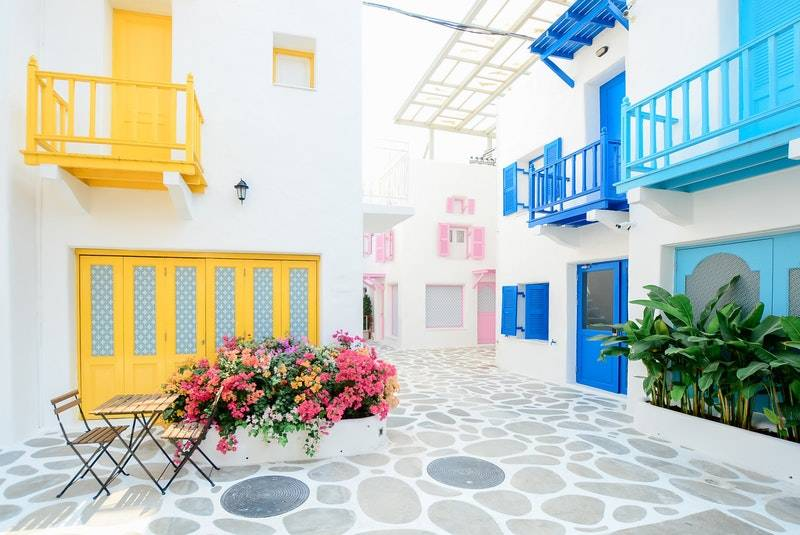 How Much Money Should I Have Saved by 30? Bright and colorful outdoor patio