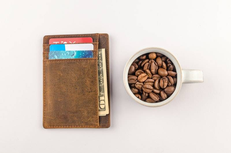 How to Get a Credit Card With No Credit: Wallet next to cup of coffee beans