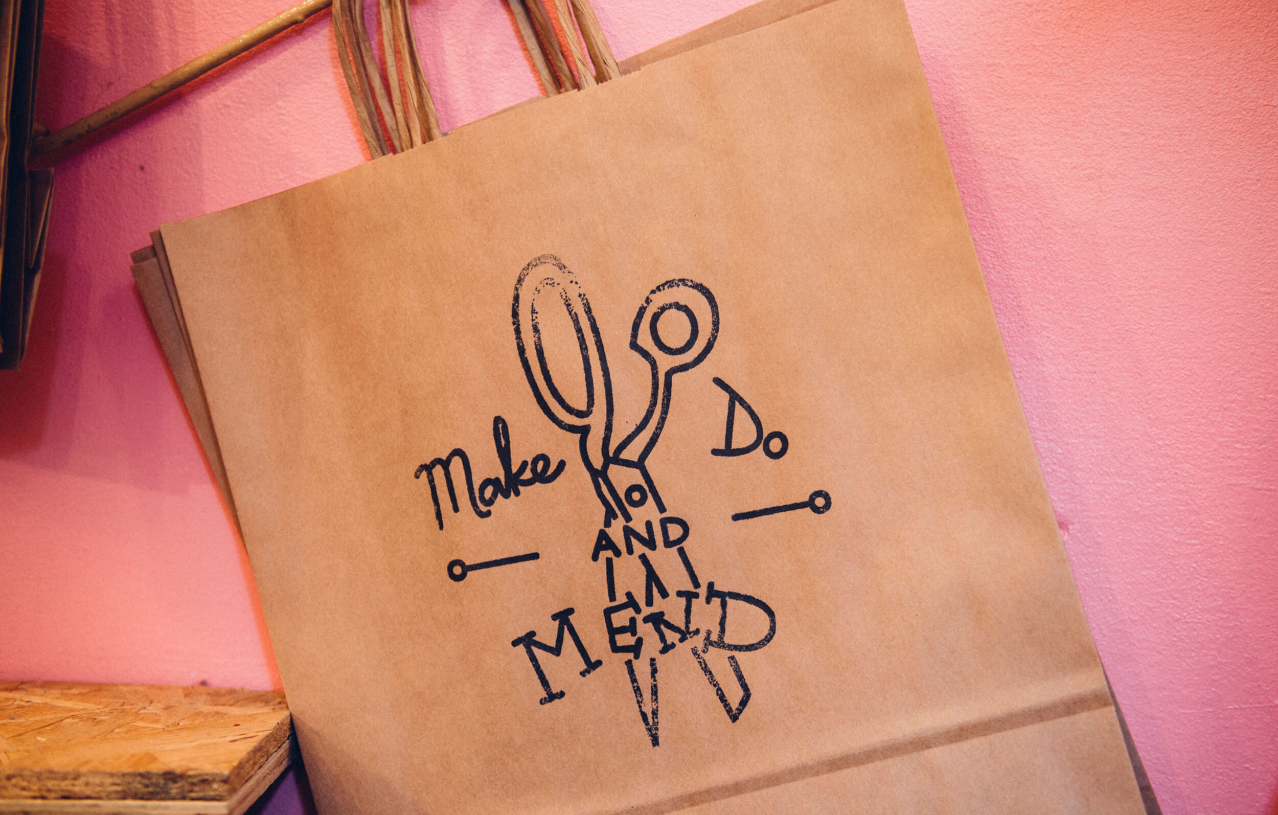 The Make Do and Mend logo, designed by Talking Horse, stamped on a brown bag