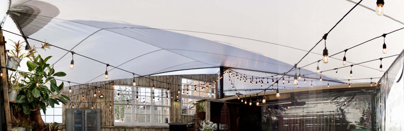 Commercial white shade sails with lights.