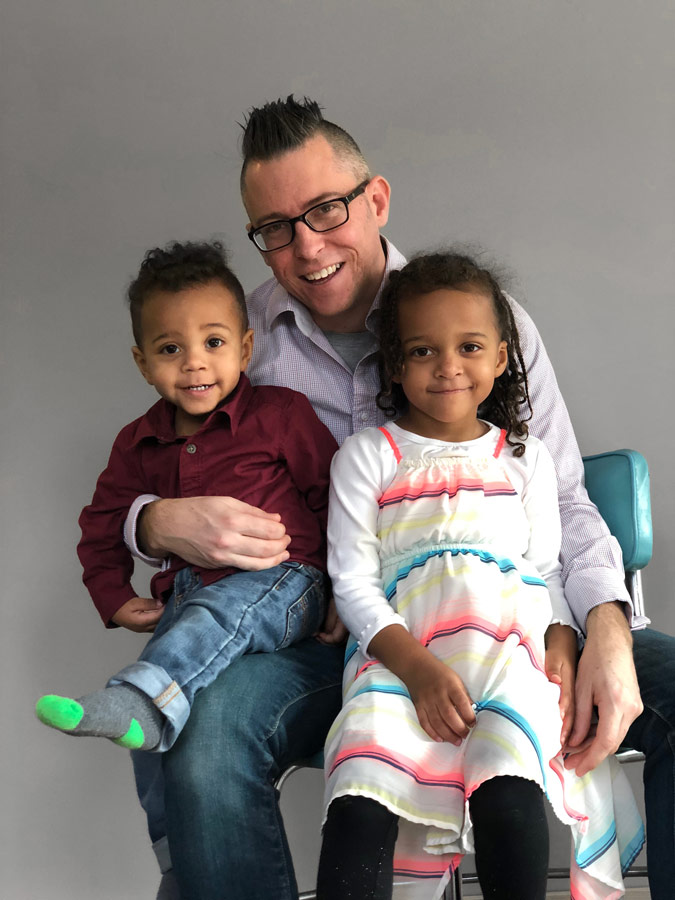 Michael Ward and kids smiling image