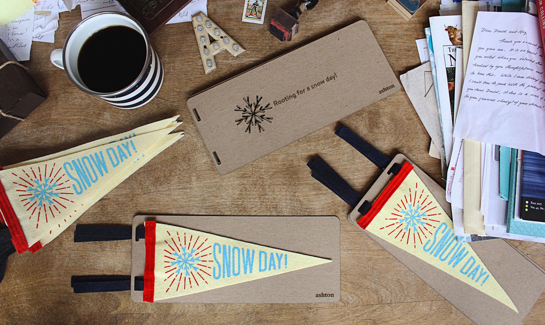snow day pennants arranged on a desk