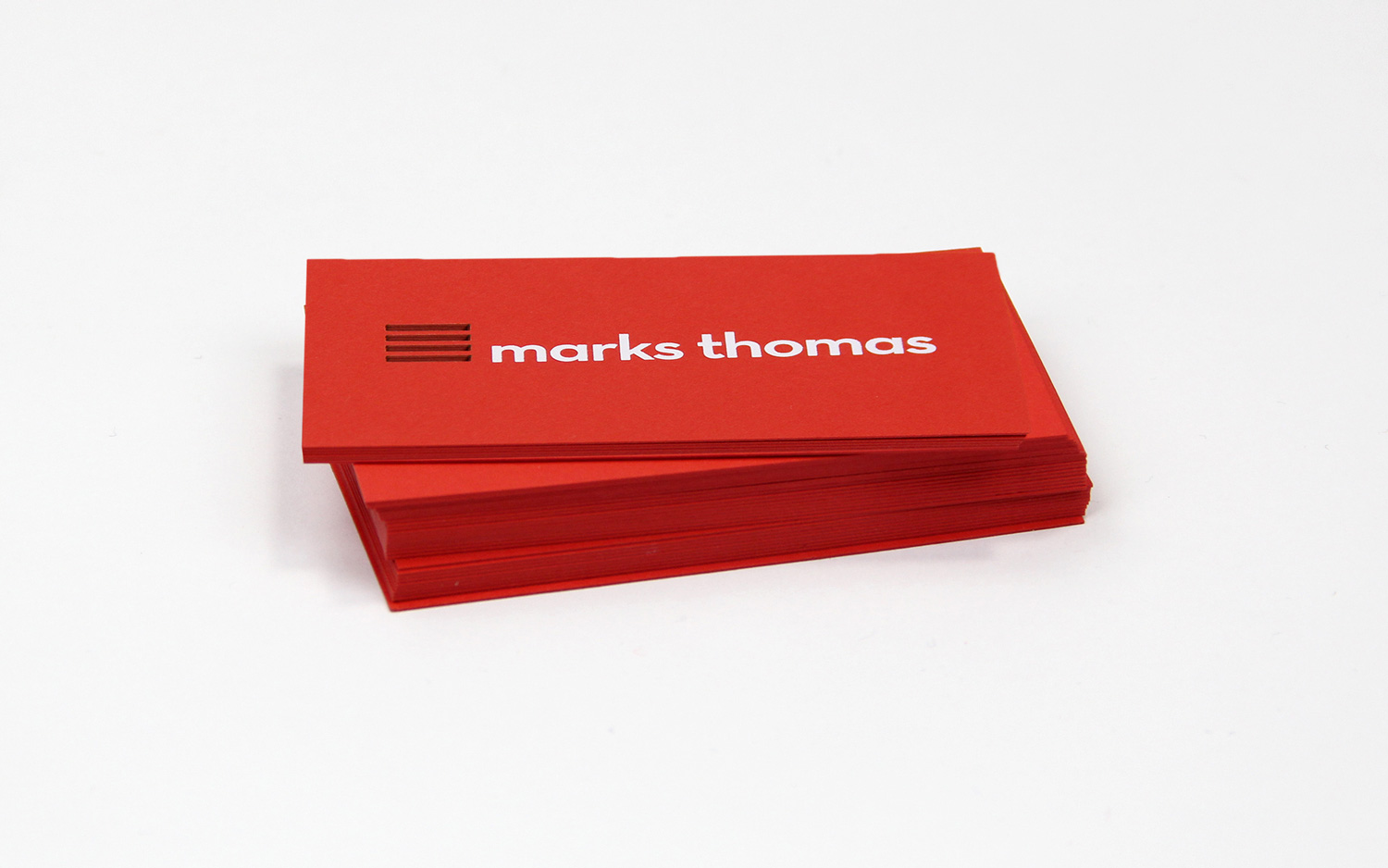 stack of marks thomas business cards