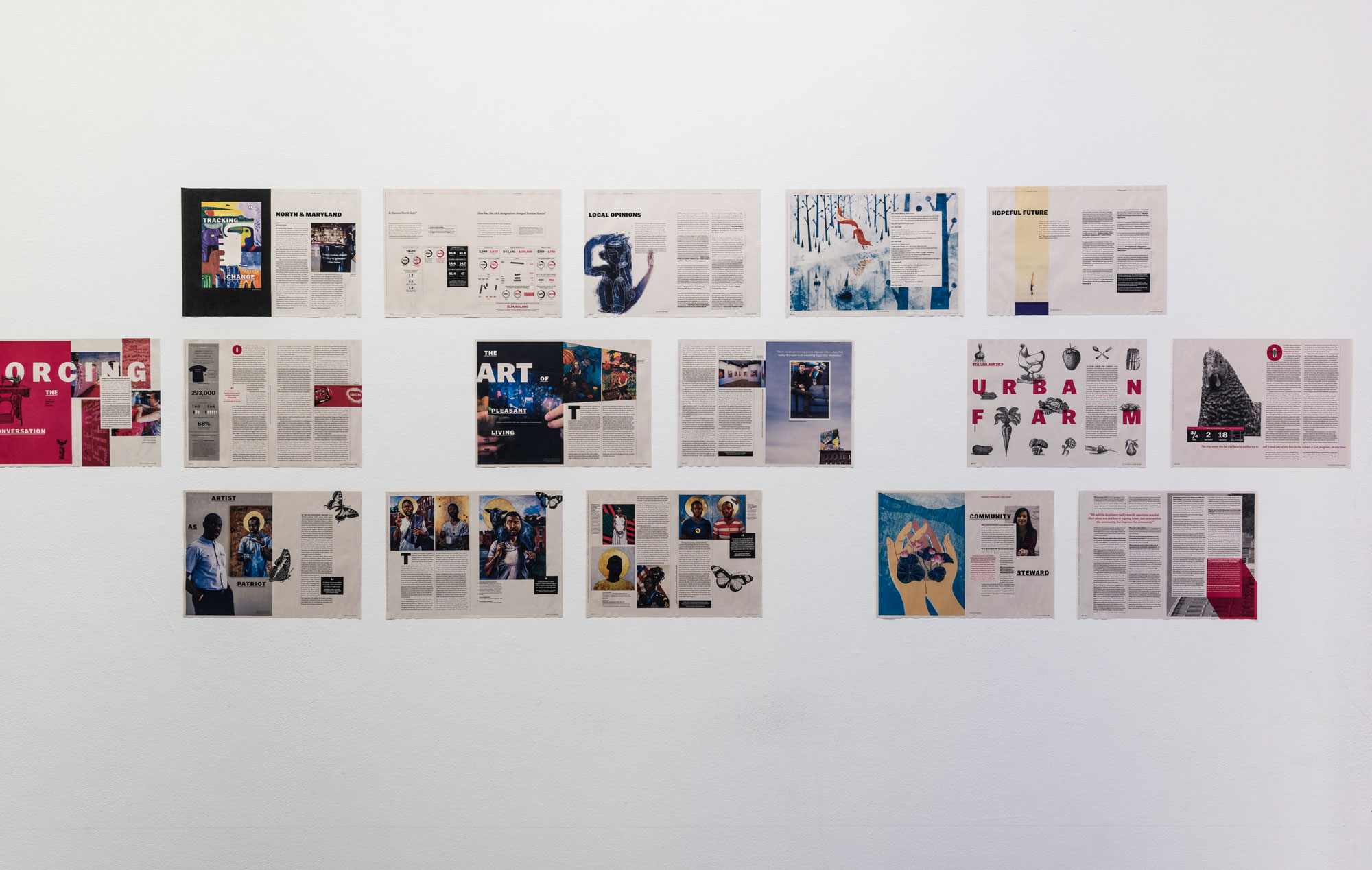 publication spreads hanging on the wall