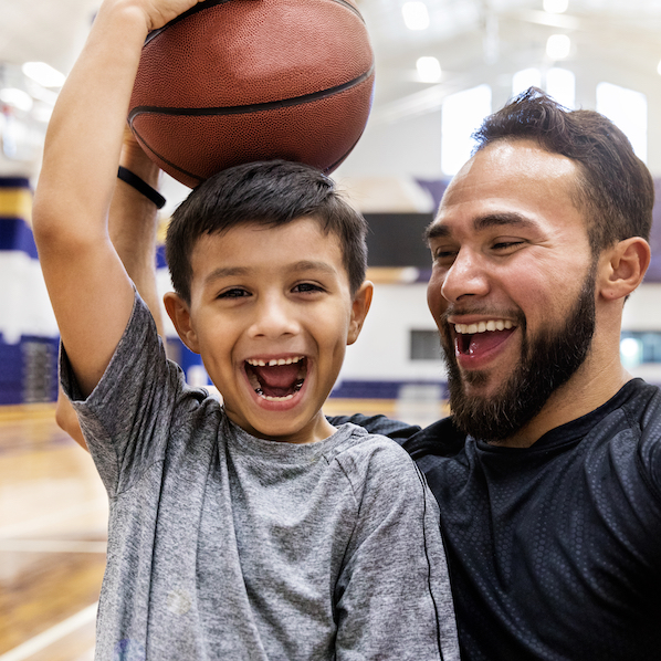 image of smiling kid and basketball