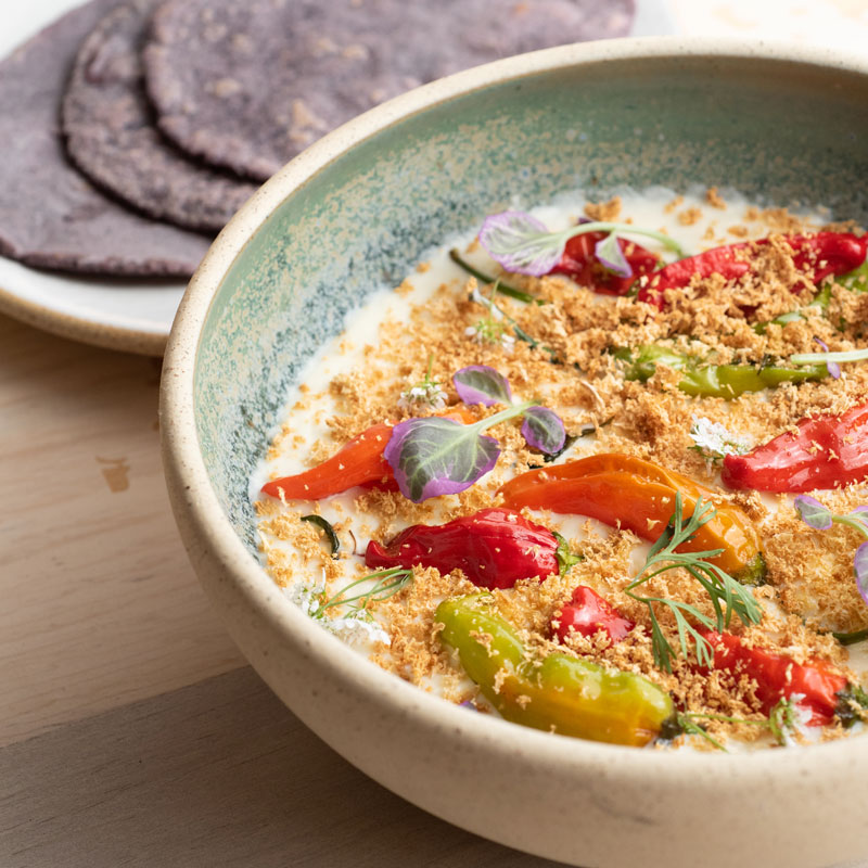 Cauliflower queso with shishito peppers