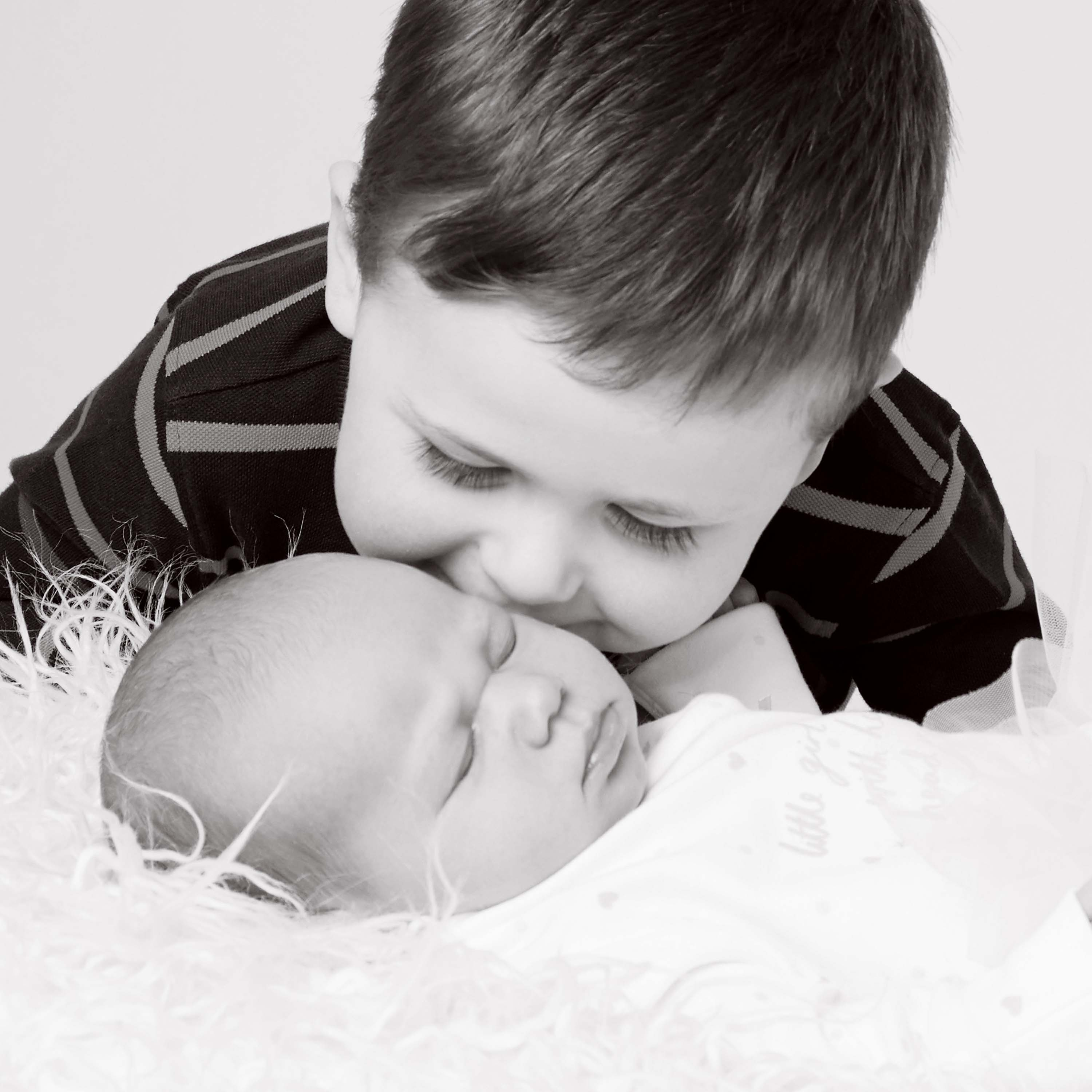 Brother and Newborn baby kisses photography