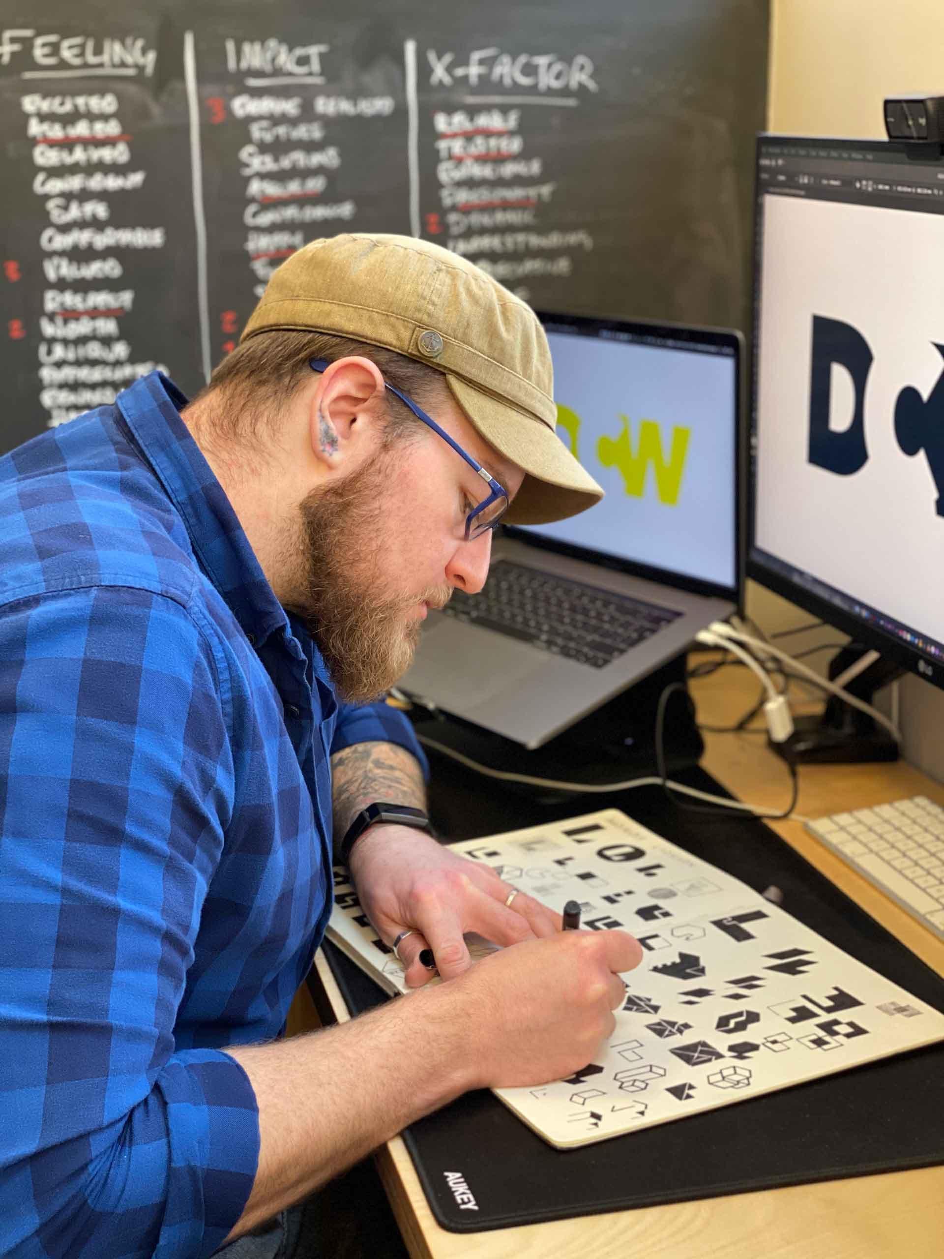 David sketching at his desk