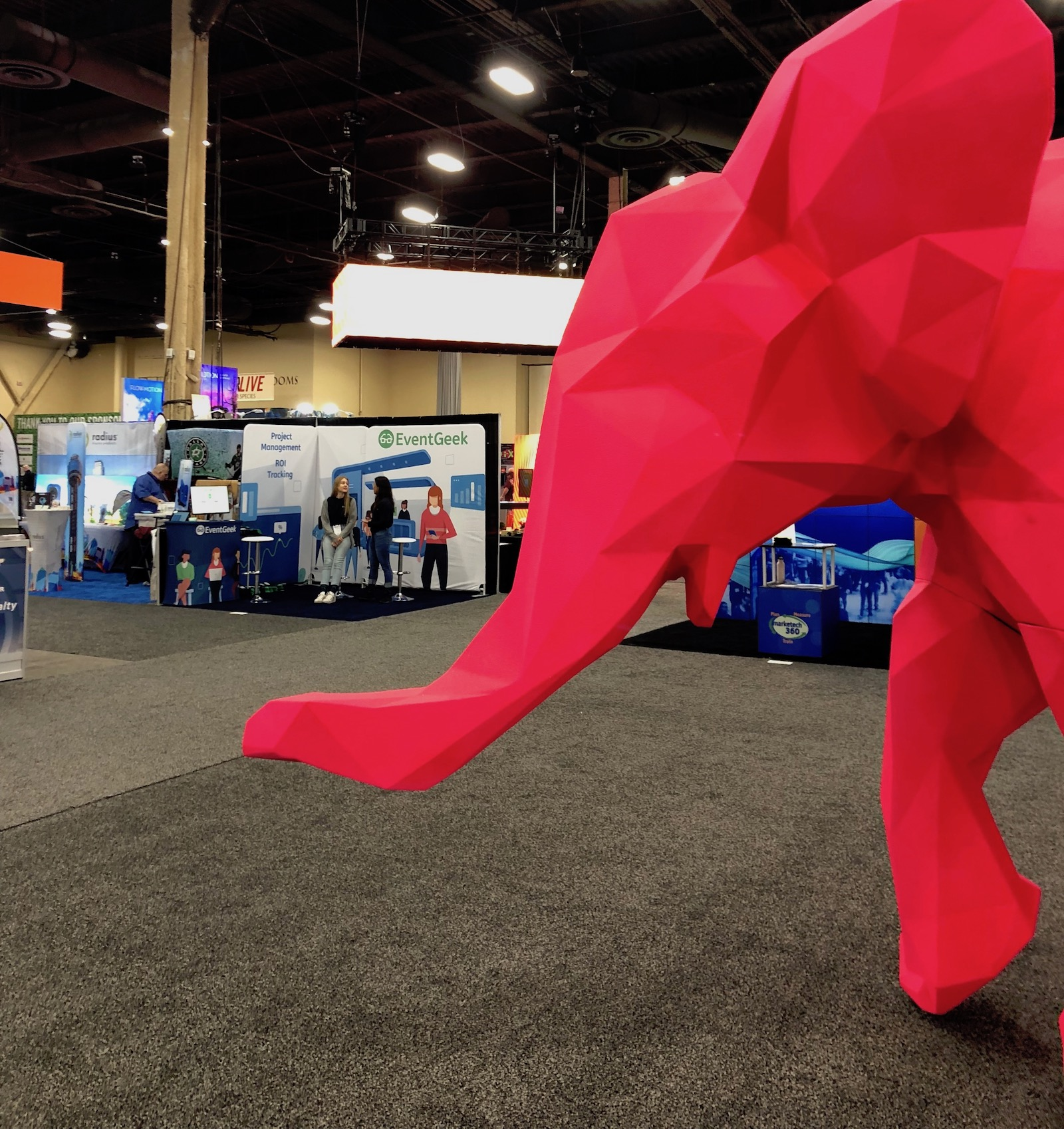 giant pink elephant and EventGeek booth at ExhibitorLive 2019