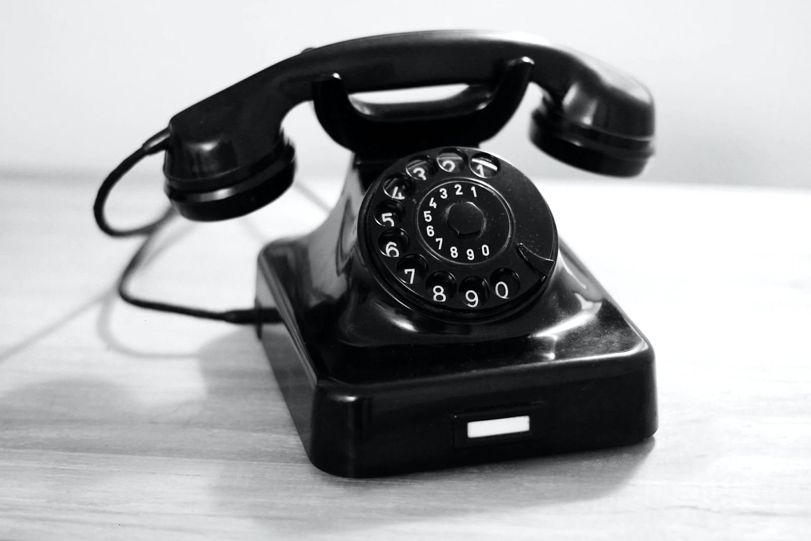 Black and white photograph of a rotary telephone.
