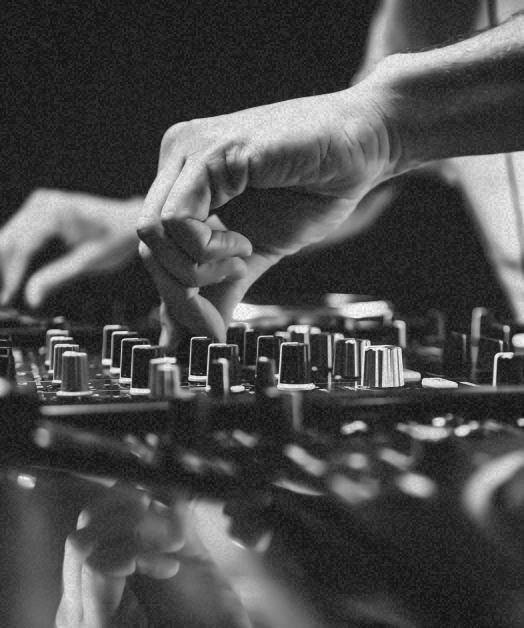 guy adjusting music controls