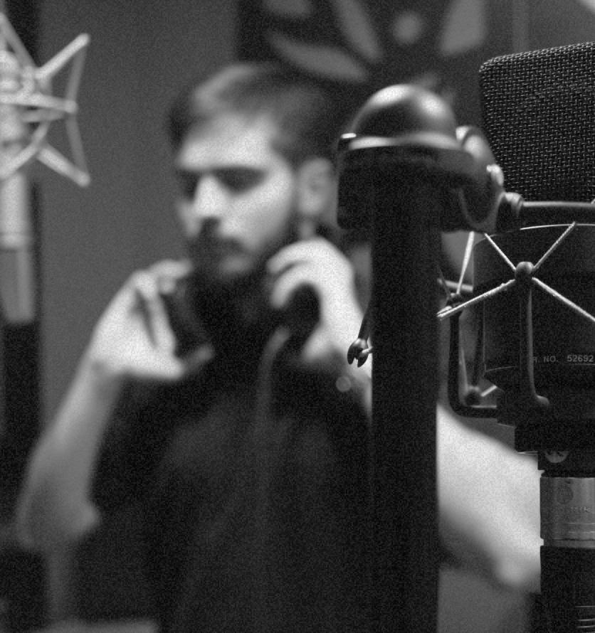 guy in a music recording studio