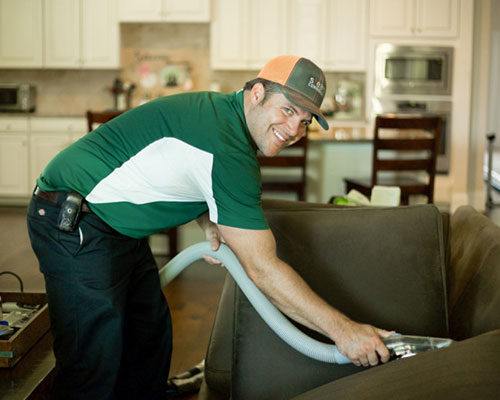 Cody, owner of Steam Commander, cleaning uphholstery