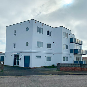 External commercial building decorating white render