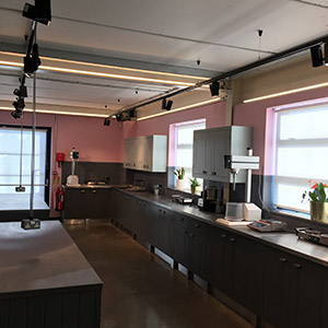 Commercial building decoration kitchen area with pink walls