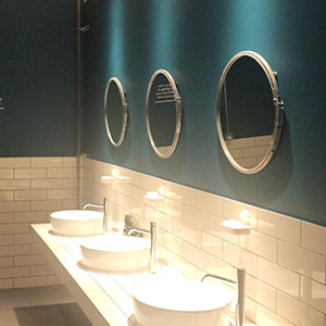 Commercial bathroom decorating services green paint in washroom