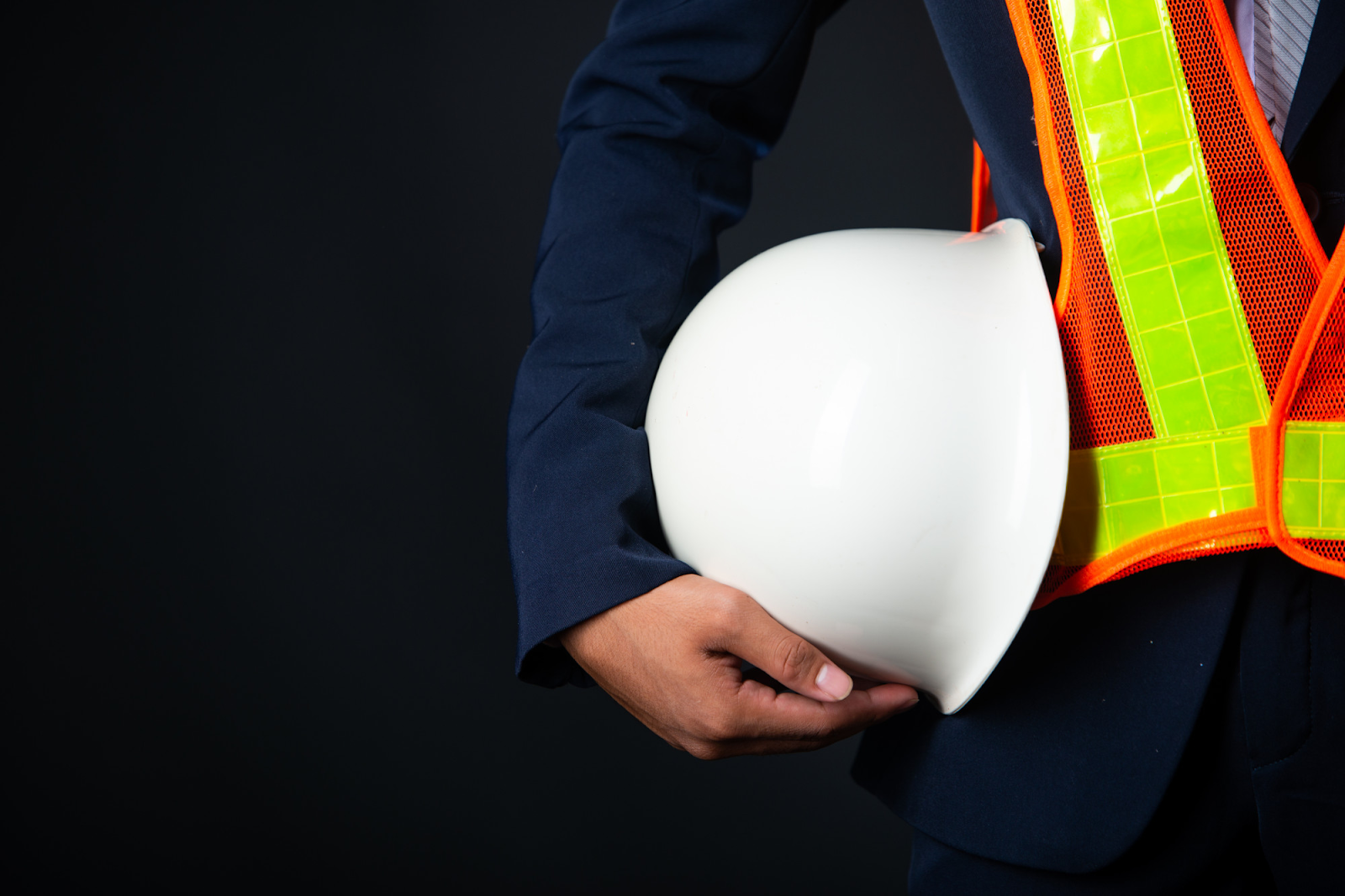engineer holding a white construction helmet