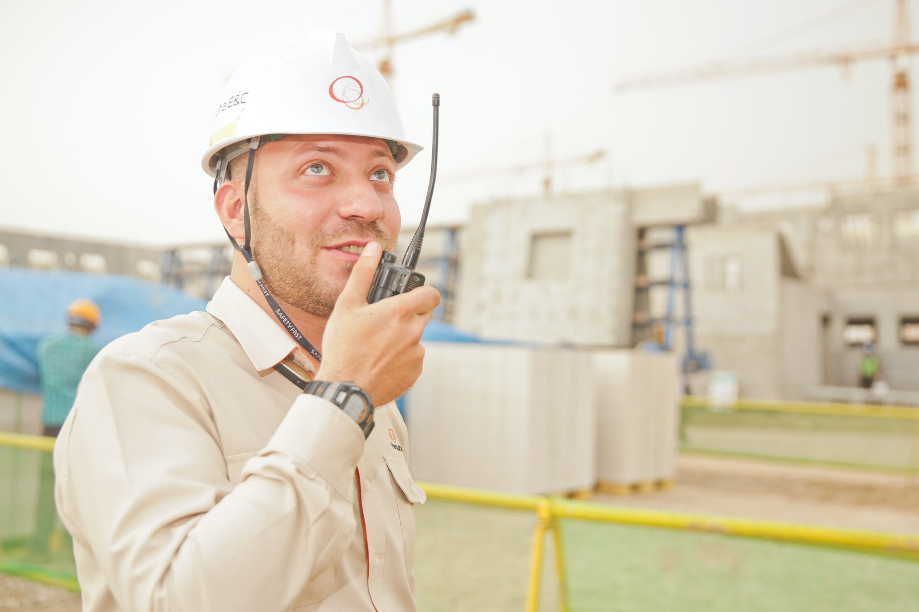 man talks on radio in construction site